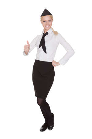 an attendant: Portrait of beautiful young stewardess. Isolated on white Stock Photo