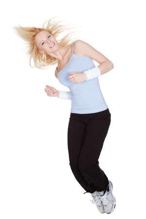 zumba: Hermosa mujer disfruta de Zumba Fitness. Aislados en blanco Foto de archivo