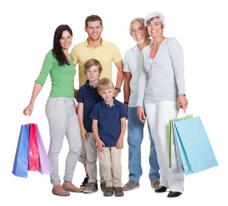 happy family shopping: Happy generations family with shopping bags. Isolated on white Stock Photo