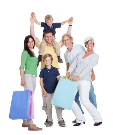 Happy generations family with shopping bags. Isolated on white Stock Photo