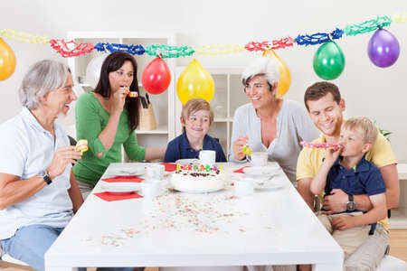 Big family celebrating birthday together at home photo