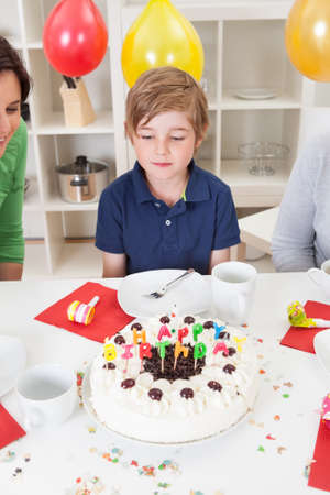 Portrait of cute boy at his birthday party Stock Photo - 14981643