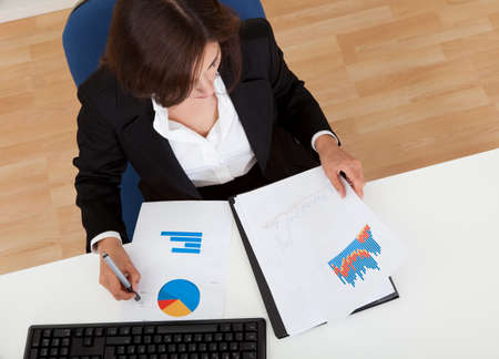 Overhead view of a businesswoman working in office Stock Photo - 15179402