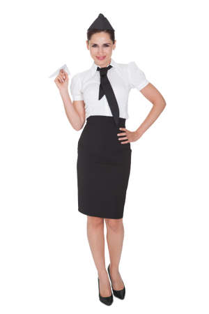 arms in air: Portrait of beautiful sophisticated stylish stewardess. Isolated on white Stock Photo