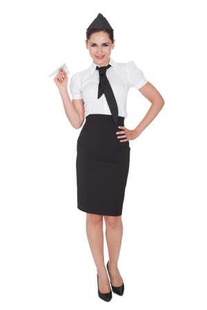an attendant: Portrait of beautiful sophisticated stylish stewardess. Isolated on white Stock Photo