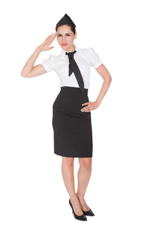 airline hostess: Portrait of beautiful sophisticated stylish stewardess. Isolated on white Stock Photo