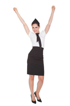 Beautiful sophisticated stylish woman with her arms raised in jubilation and celebration of her success isolated on white. Isolated on white photo