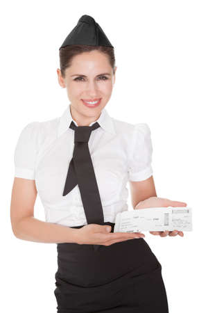 an attendant: Smiling welcoming hospitality hostess presenting a voucher in her hands isolated on white Stock Photo
