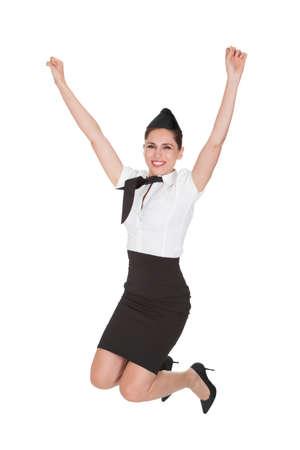 stewardess: Excited young woman jumping. Isolated on white Stock Photo