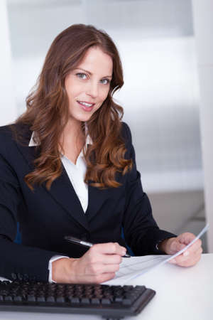 Smiling businesswoman working at her computer in the office Stock Photo - 15175543
