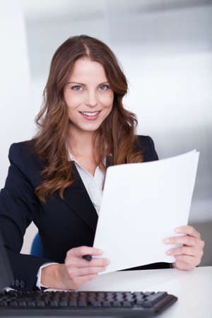 Smiling businesswoman working at her computer in the office Stock Photo - 15175446