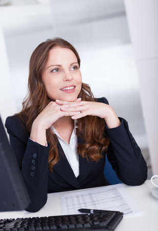 Smiling professional business secretary or personal assistant working at her computer typing on the keyboard Stock Photo - 15175609