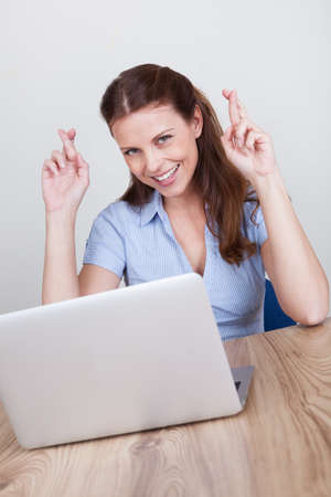 Upbeat successful young woman sitting at her laptop making a fist of jubilation and celebration Stock Photo - 15175625