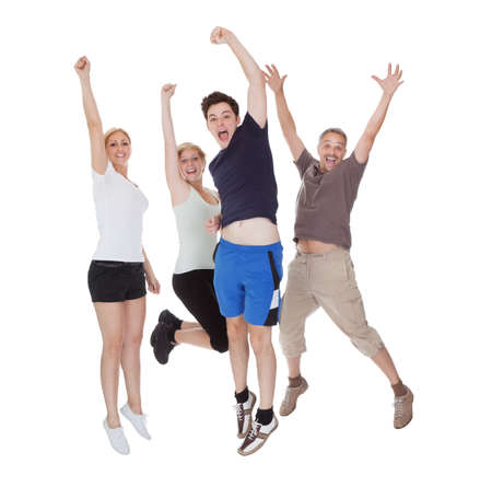 Happy excited family jumping. Isolated on white photo