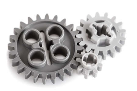 toothed: Set of toothed gears of different sizes for transmitting motion and changing direction in a mechanical device