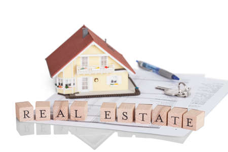 Wooden blocks spelling the words Real Estate on a legal document photo