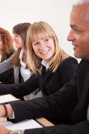 Portrait Of Young Business Woman In Meeting With Colleagues photo