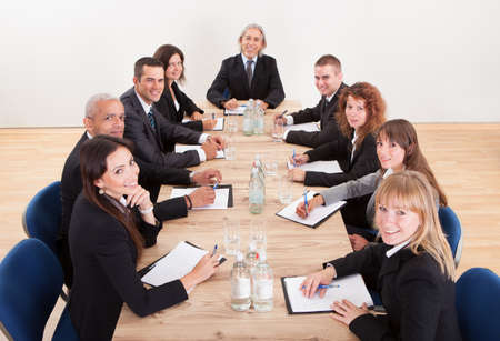 Portrait Of A Serious Business Men And Women Attending A Seminar photo