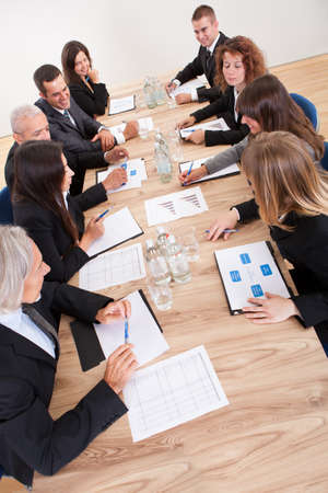 topdown: Portrait Of A Serious Business Men And Women Attending A Seminar Stock Photo