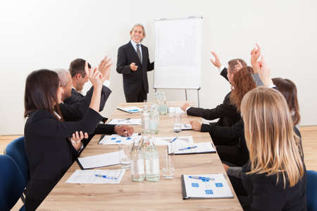 Businessman Raising His Hand Up At A Conference Stock Photo - 15404060