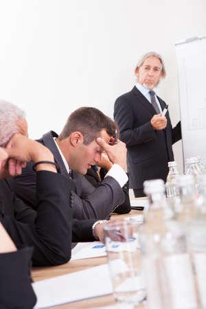 unsatisfactory: Photos Of Sad Business Team Attending The Seminar