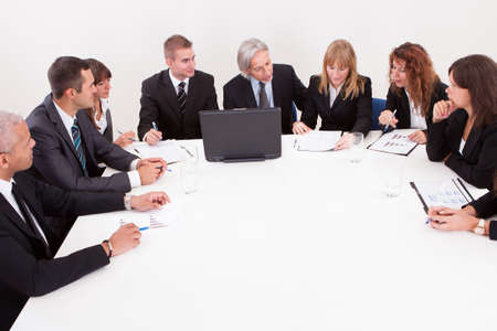 Businesspeople Sitting At Conference Table At The Meeting Stock Photo - 15404109
