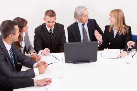 Businesspeople Sitting At Conference Table At The Meeting Stock Photo - 15404198