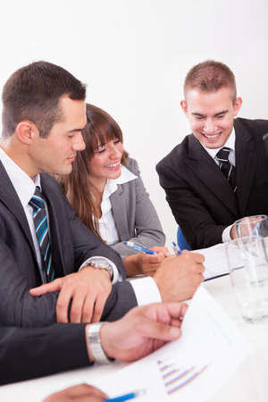 Businesspeople Sitting At Conference Table At The Meeting Stock Photo - 15404361