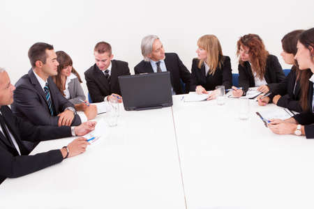 Businesspeople Sitting At Conference Table At The Meeting Stock Photo - 15404151