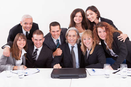Businessman Showing On Laptop In Meeting With His Colleagues photo