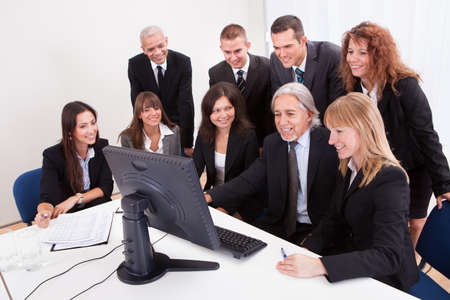Mature Businessman With  Team Discussing New Project During Meeting photo
