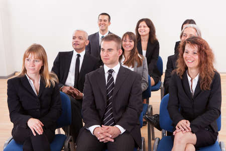 Portrait Of A Business Men And Women Attending A Seminar photo