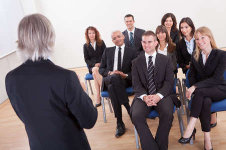 focus group: Group Of Business People Attending The Lecture Stock Photo