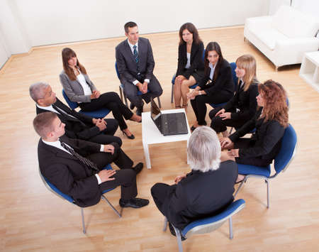 discussion group: Group Of Business People Sitting On Chair Attending The Meeting Stock Photo