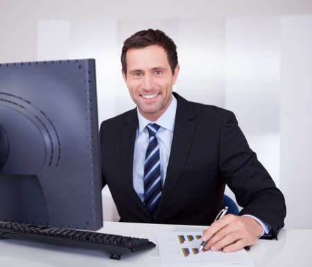 Portrait Of Happy Businessman At Workplace In the Office Stock Photo - 15404106