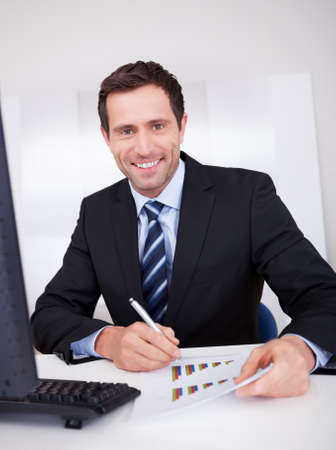 Portrait Of Happy Businessman At Workplace In the Office Stock Photo - 15403970