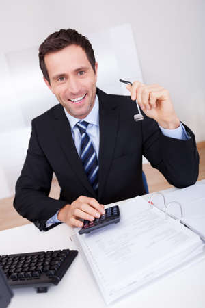 Portrait Of Happy Accountant At Workplace In The Office Stock Photo - 15404065