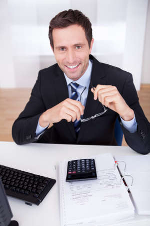 Portrait Of Happy Accountant At Workplace In The Office Stock Photo - 15404041
