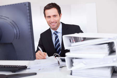 Portrait Of Happy Businessman At Workplace In the Office Stock Photo - 15404061