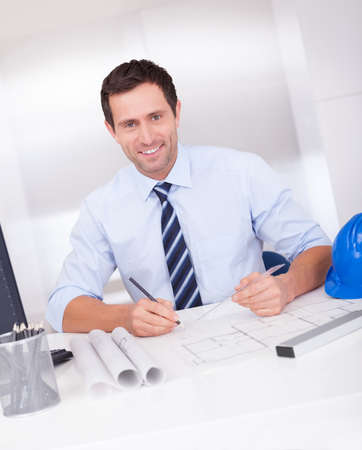 Portrait Of Architect With Blueprint In The Office Stock Photo - 15403873