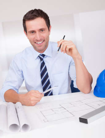 Portrait Of Architect With Blueprint In The Office Stock Photo - 15403690