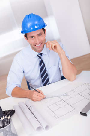 Portrait Of Architect With Blueprint In The Office Stock Photo - 15403883