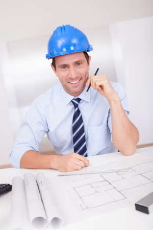 Portrait Of Architect With Blueprint In The Office Stock Photo - 15403854