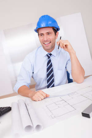 Portrait Of Architect With Blueprint In The Office Stock Photo - 15403686