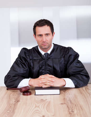 Serious Male Judge With The Gavel And Book In Courtroom Stock Photo - 15404070
