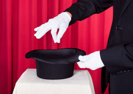 Close-up Of A Magician Performing Magic With Hat photo