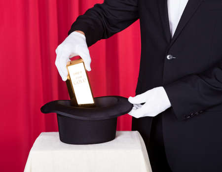 Close-up Of Magician Removing Bullion From Hat photo