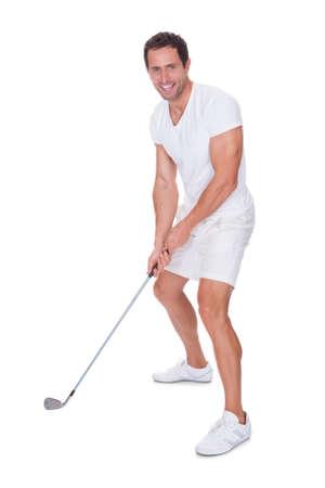 teen golf: Después de oscilación Golfista Aislado En Un Fondo Blanco