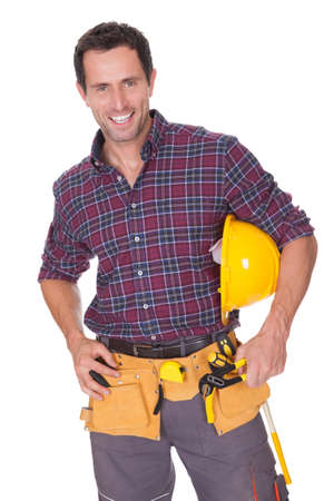 Young Worker Man With Hard Hat On White Background photo