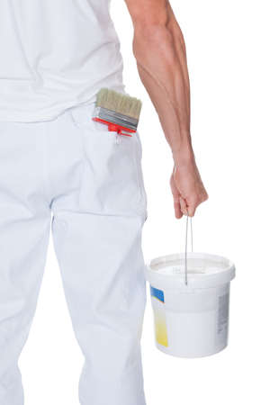 home decorating: Painter Holding A Paint Roller And Bucket On White Background